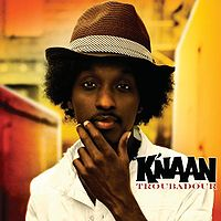 """Troubadour"" von K'NAAN hat einen Notendurchschnitt von 1,898 bekommen - Das Original Album ist aktuell um den Coca Cola Celebration Mix des Songs ""Wavin The Flag"" ergänzt worden"